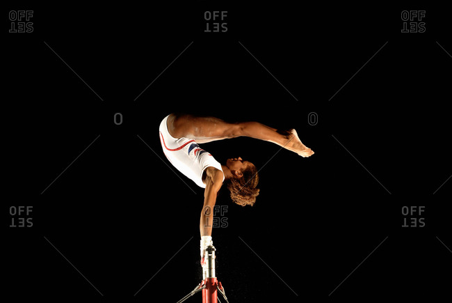 gymnast on high bars