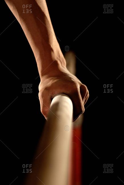 gymnast's hand grabbing bar