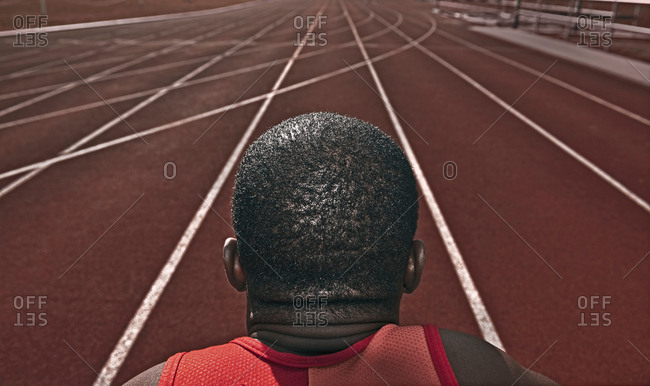 Male athlete staring down running track