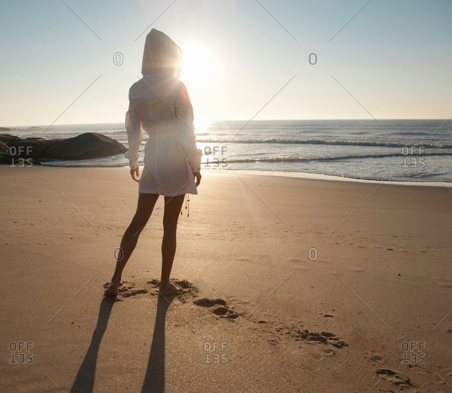woman at the beach looking into distance