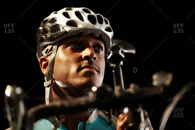 Man poised on bike - Offset