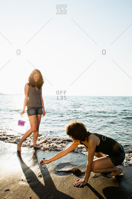 Women playing together on beach