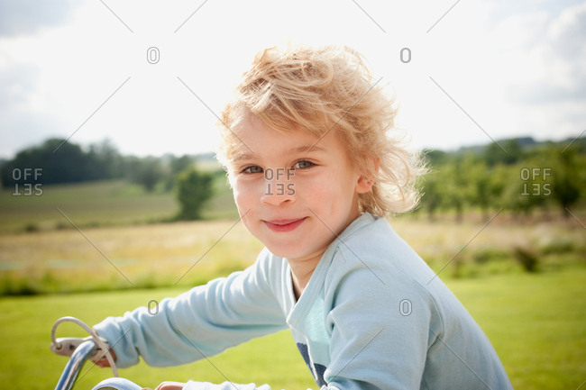 Boy on bicycle in countryside