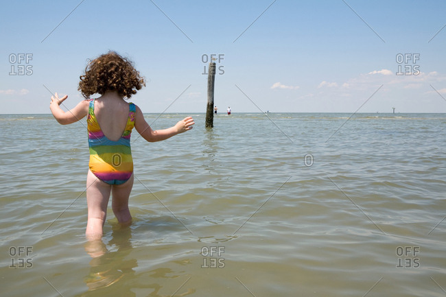 Young girl paddling in water