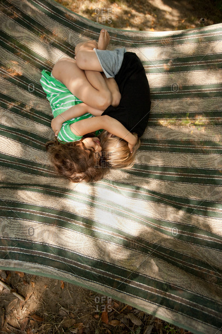 Two children lying on hammock