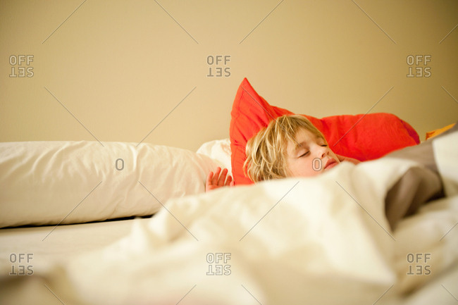 Boy asleep in bed