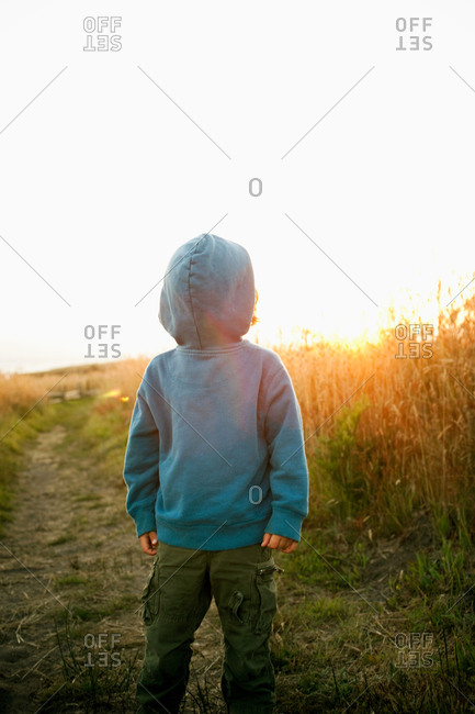 Boy wearing hooded top back to front