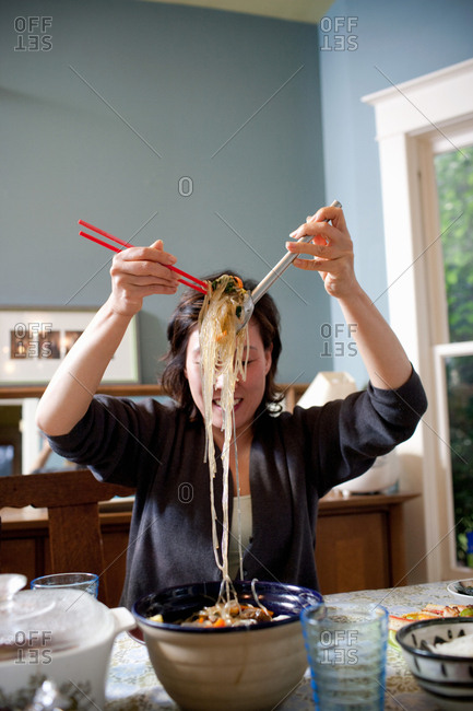Woman with bowl of noodles