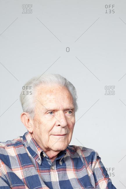 Senior man looking away, studio shot