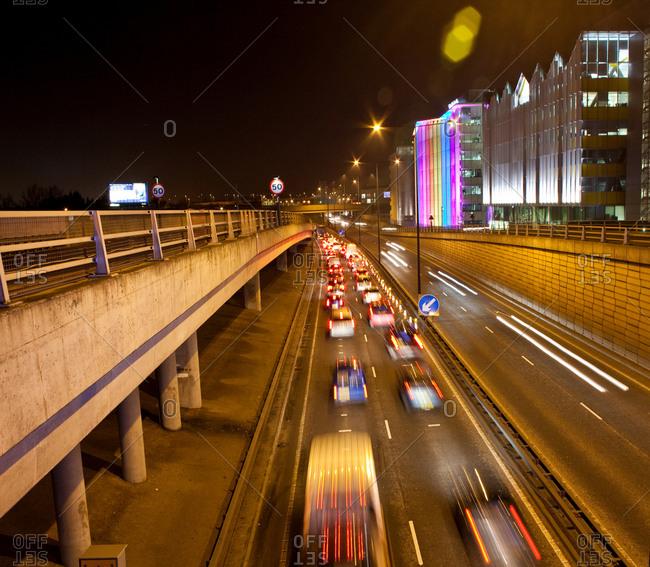 London, England - April 21, 2017: Traffic on road in urban scene at night, London, England