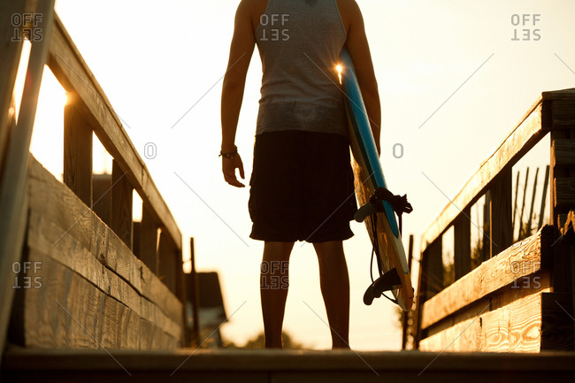 Teenager standing in anticipation ready to surf