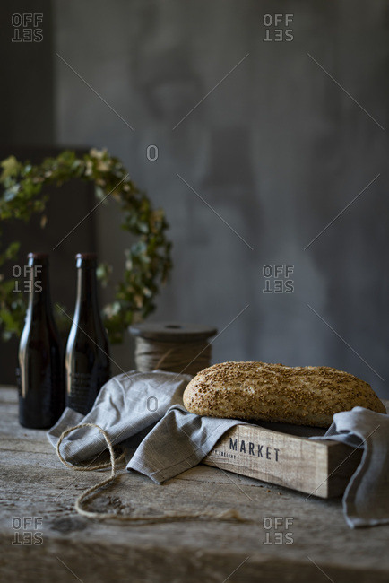 A loaf of seeded bread on a rustic background