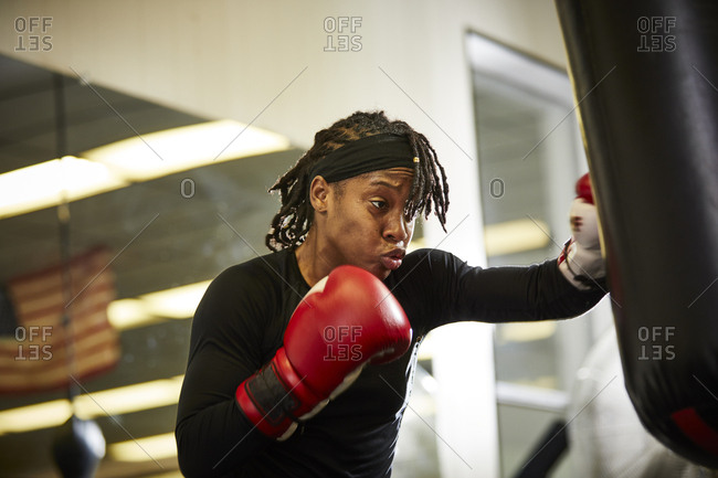 Low angle view of determined female boxer practicing in gym