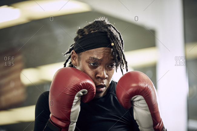 Determined female boxer  in gym