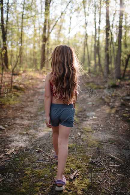 Girl strolling in country forest