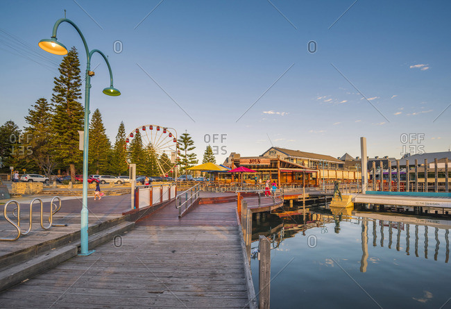 Fremantle, Australia - November 14, 2016: Fremantle, Perth, Western Australia, Australia. The waterfront of the Fremantle Harbor at sunset.