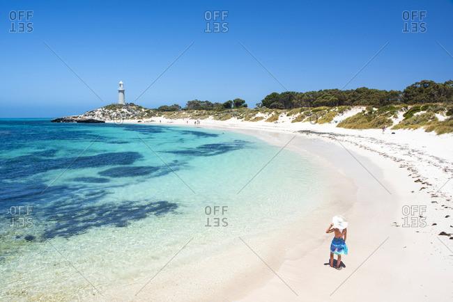 Rottnest Island, Fremantle, Perth, Western Australia, Australia. Woman on the beach at The Basin, the most popular swimming location of the island