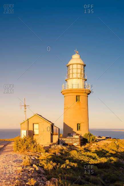 Exmouth, Western Australia - November 18, 2016: Exmouth lighthouse (Vlamingh Head Lighthouse), Exmouth, Western Australia, Australia. Lighthouse at sunset.