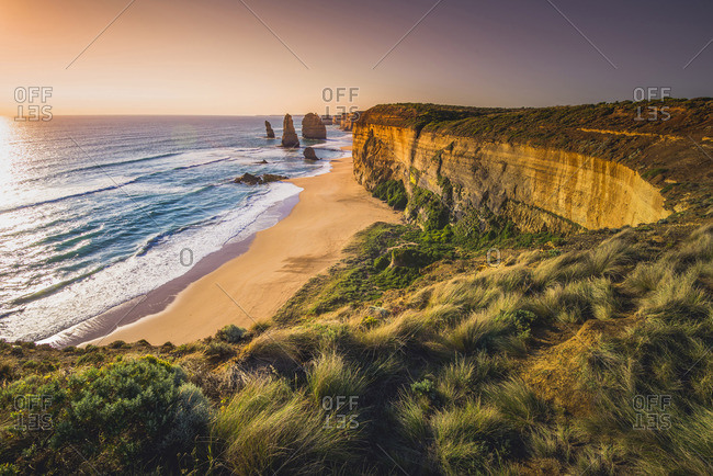 The Twelve Apostles, Port Campbell National Park, Victoria, Australia. The Limestone stacks and the coast at sunset.