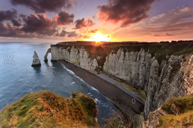 Sunrise over the cliff of Etretat in Normandy, France.