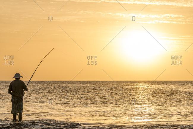 africa, Cape Verde, Santiago. A fisherman at sunset in Tarrafal