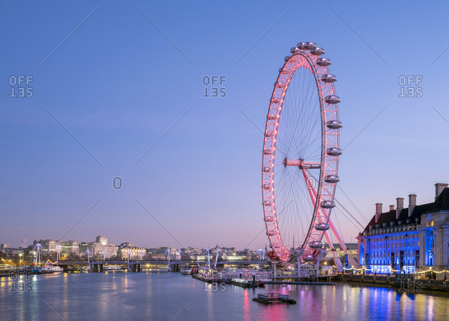 London, England - January 21, 2017: London Eye observation wheel on the River Thames at dawn.