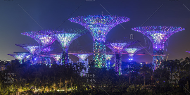 Singapore - November 4, 2016: Singapore, Republic of Singapore, Southeast Asia. People walking on the elevated platform at the Gardens By The Bay at night.