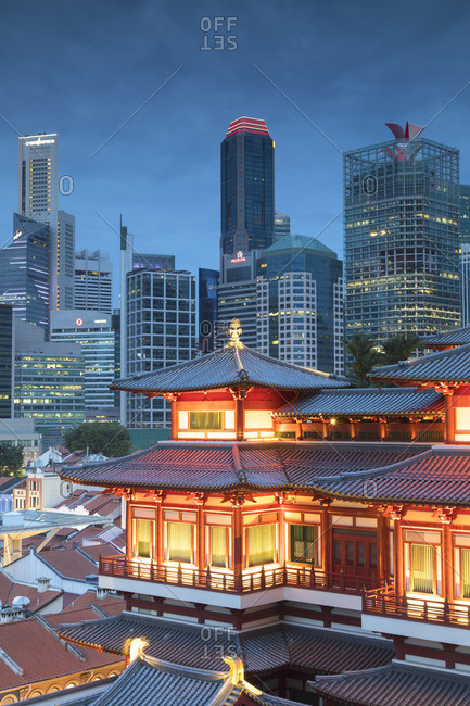Singapore - January 28, 2017: Buddha Tooth Relic Temple and skyscrapers at dusk, Chinatown, Singapore