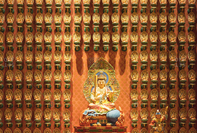 Buddha statues in Buddha Tooth Relic Temple, Chinatown, Singapore