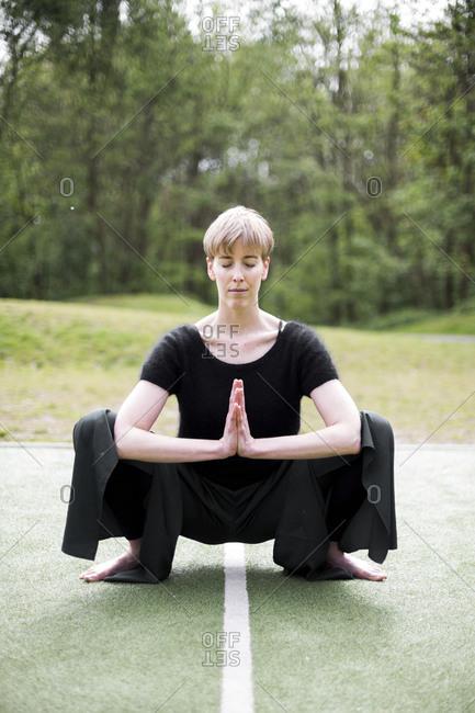 Woman practicing yoga asana outdoors