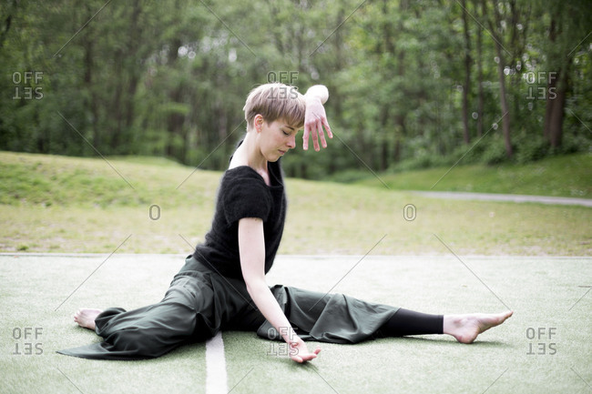 Woman doing yoga poses outdoors