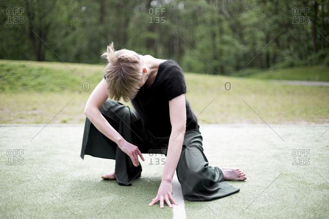 Woman doing yoga asanas outdoors
