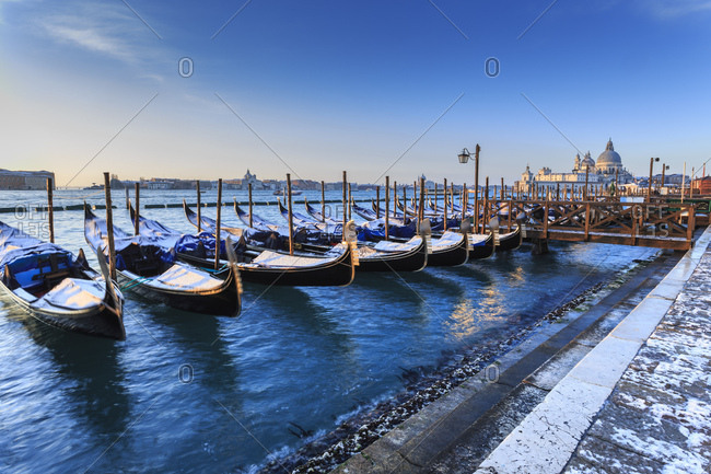 Veneto, Italy - January 14, 2017: Gondolas with view to Basilica di Santa Maria della Salute after snow, Venice, UNESCO World Heritage Site, Veneto, Italy, Europe