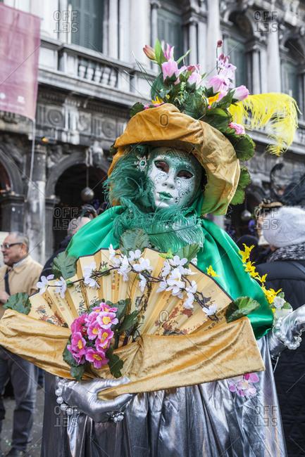 Veneto, Italy - February 18, 2012: Colorful mask and costume of the Carnival of Venice, famous festival worldwide, Venice, Veneto, Italy, Europe