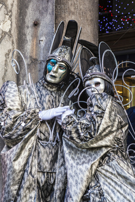 Colorful masks and costumes of the Carnival of Venice, famous festival worldwide, Venice, Veneto, Italy, Europe