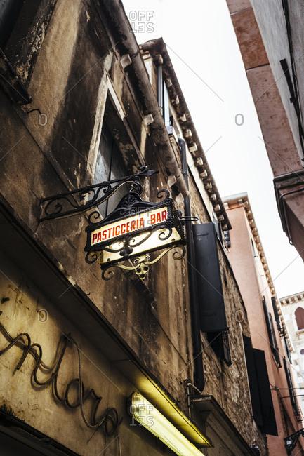 Venice, Italy -  September 30, 2015: Street sign of a bakery on a narrow street