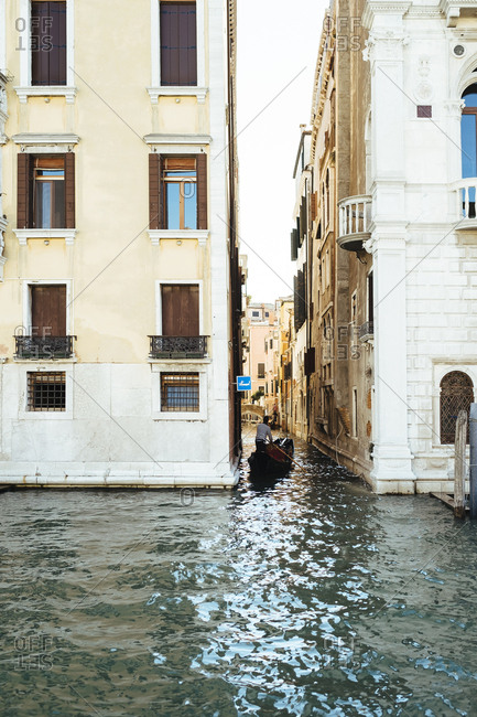 Gondola entering small canal off the Grand Canal, Venice, Italy