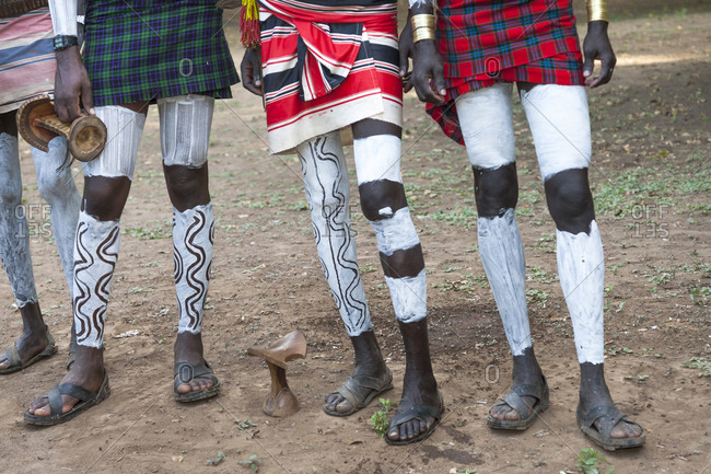 Africa, Ethiopia, Southern Omo, Murulle, Karo Tribe. Decorated legs of Karo men in preparation for the dance.