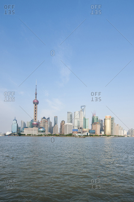 Shanghai, China - May 26, 2012: Pearl Tower over Pudong district skyline and Huangpu River, Shanghai, China.