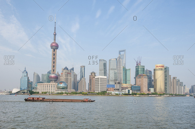Shanghai, China - May 26, 2012: Pudong district skyline with shipping on the Huangpu River, Shanghai, China.