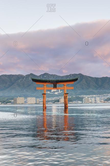 Japan, Miyajima, Itsukushima Shrine, Floating Torii Gate at Sunrise