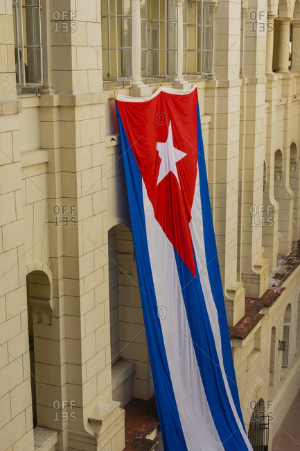Cuba. Havana. Museum of the Revolution. Giant Cuban flag hanging in an interior courtyard.