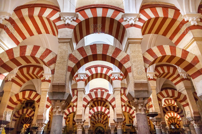 Arches Pillars Mezquita, Cordoba, Spain. Created in 785 as a Mosque, was converted to a Cathedral in the 1500. 850 Columns and Arches
