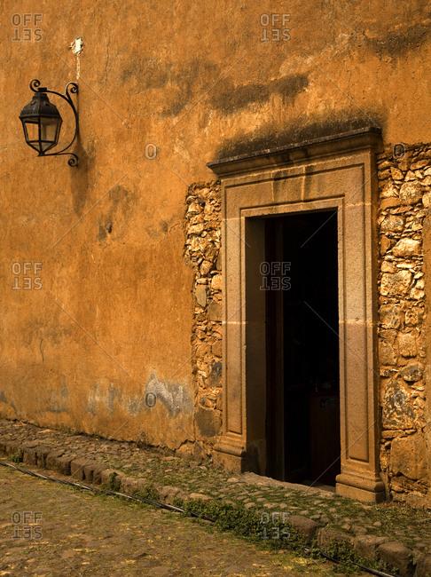 Yellow Brown Adobe Wall and Door Plus Lantern Patzcuaro Mexico