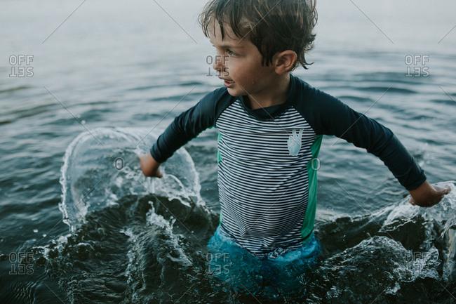Young boy splashing in water