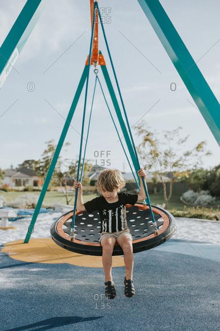 Child swinging on playground swing