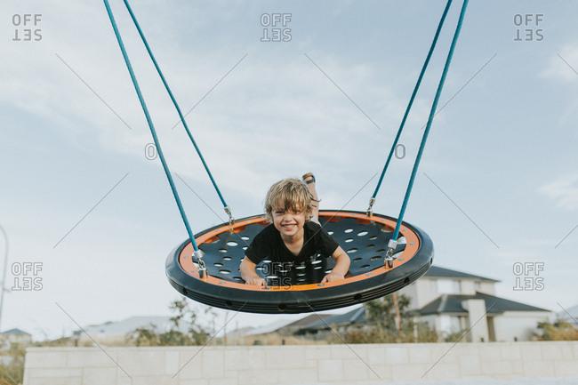 Child swinging on round swing