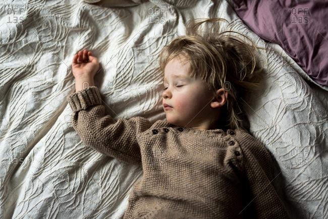 Sleepy toddler girl taking nap