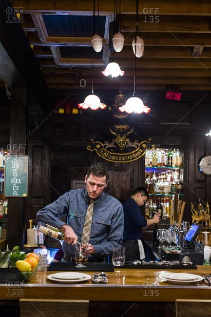 Lyle, Washington - January 4, 2017: Men working behind restaurant bar