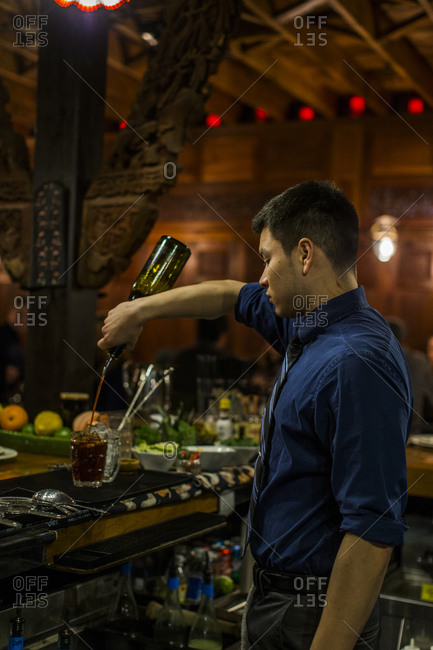 Lyle, Washington - January 4, 2017: Bartender in restaurant mixing drinks